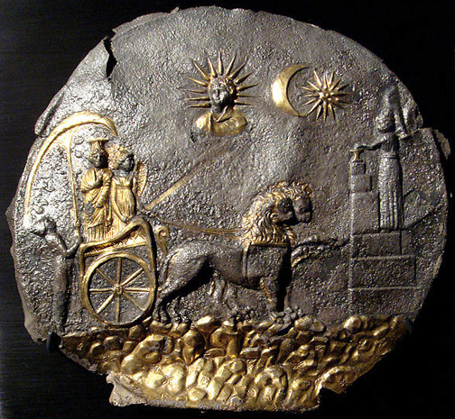 silver disc with two goddesses in a chariot, sun and moon above, and a magus