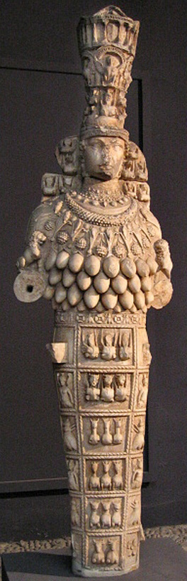 marble sculpture of Artemis of Ephesus with fruited pectoral, outstretched hands, and tall polos headdress