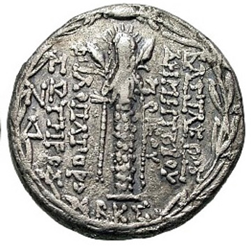 silver coin with crowned goddess