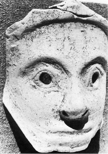 ceramic mask of young woman