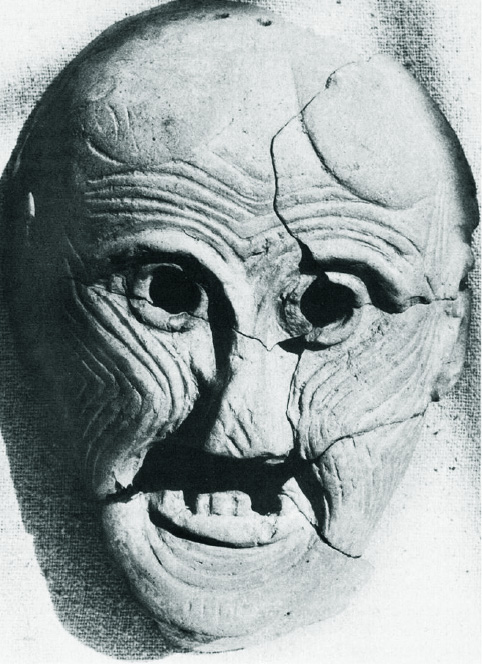 old woman's face with swirling line patterns and a few missing teeth, smiling