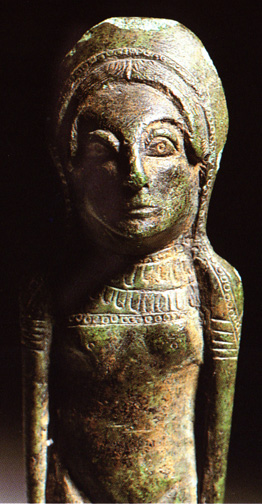 standing bronze woman with ornaments